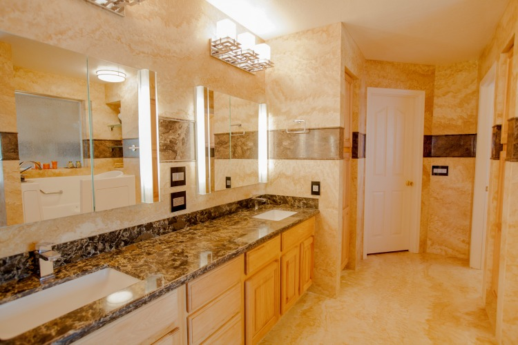 Mesa, AZ bathroom remodeling contractor featuring Forza Stone panels, accessible shower and a walk-in tub.