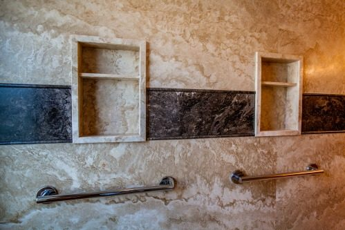 Master bathroom addition in Phoenix, Arizona -  featuring Forza Stone panels, an accessible shower and a walk-in jetted tub.