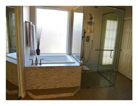 Ahwatukee AZ master bathroom remodel with an accessible shower and soaking tub.