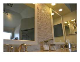 Gilbert AZ master bathroom remodel with soaking tub, a large open shower and light quartz counters.
