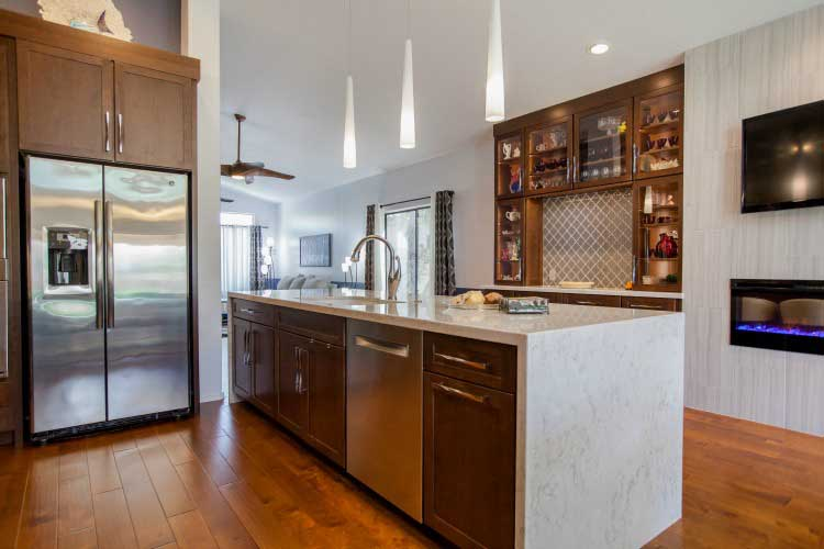 Kitchen Remodeling contractor in Mesa, AZ. Large open concept modern style kitchen remodel with island seating, stainless appliances and cherry cabinets.