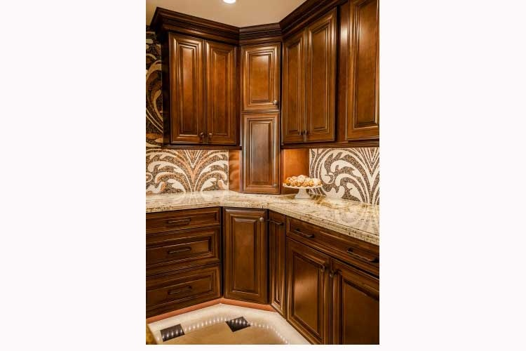 Paradise Valley Kitchen remodeling Contractor-Luxurious kitchen renovation with a large island, two toned wood cabinets, a stone cook-top hood and LED lighting.