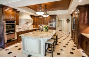 Gilbert, AZ Home Remodeling Contractor.Open concept kitchen remodel with dark wood cabinets and island seating.