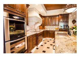 Gilbert AZ open concept kitchen remodel with dark wood cabinets and island seating.