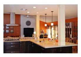 Gilbert AZ open concept kitchen remodel with dark wood cabinets and peninsula seating.