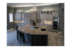 Ahwatukee AZ kitchen remodel with custom gray cabinetry and a large island with seating..