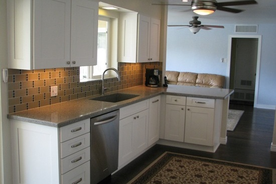 Mesa, AZ kitchen remodeling contractor. Open concept galley kitchen with gray quartz counter tops and white cabinets.