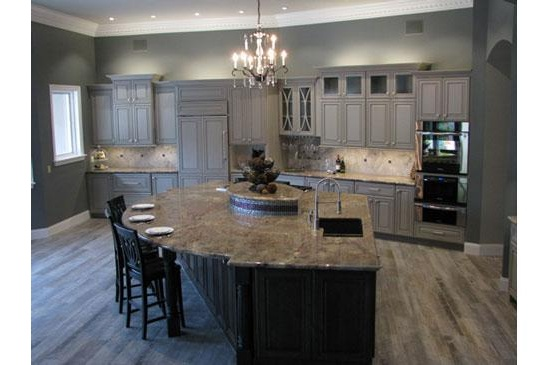 Scottsdale kitchen remodeling contractor featuring an open, modern kitchen, large functional island and chandelier.