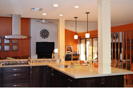 Scottsdale, AZ Kitchen remodeling Contractor featuring peninsula seating, columns and pendant lighting.