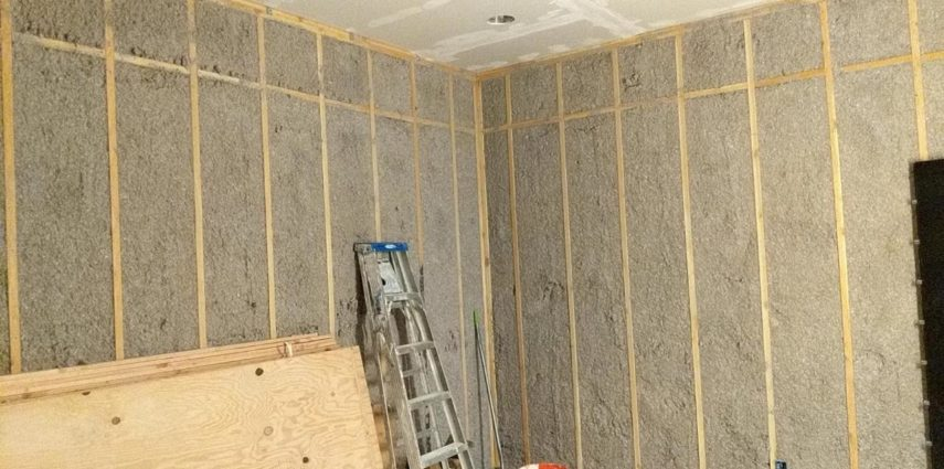 All that blown insulation settled into its spaces. Drywall installed on the ceiling. Plywood acclimating so it can be ready to sheet the walls once the ceiling is complete.